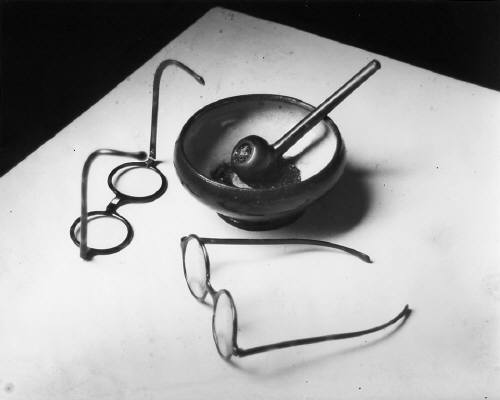 Mondrian's Glasses and Pipe by Andre Kertesz - 1926